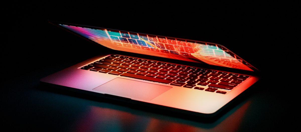 semi-opened-laptop-computer-turned-on-on-table-2047905_1